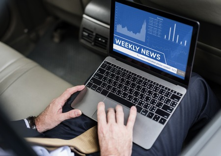 Laptop with weekly news concept Banque d'images