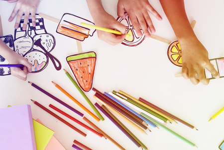 Children participating in drawing class Stock Photo