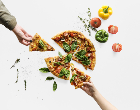 Hands taking slices of italian cuisine pizza