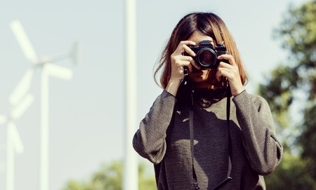 Woman Taking Snap Photo with Camera Wanderlust Stock Photo