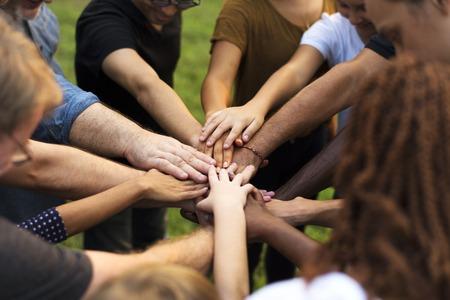 Group of diversity people hands stack support together Foto de archivo