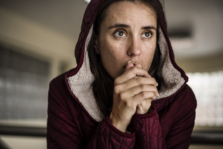 Cold Hopeless Woman Sitting Thoughtful Stock Photo