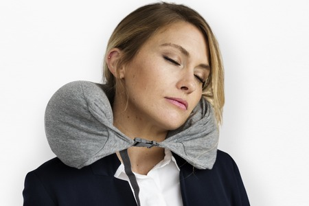 Businesswoman with travel pillow