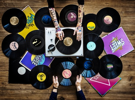 Hands with Vinyl Record Player Music Фото со стока