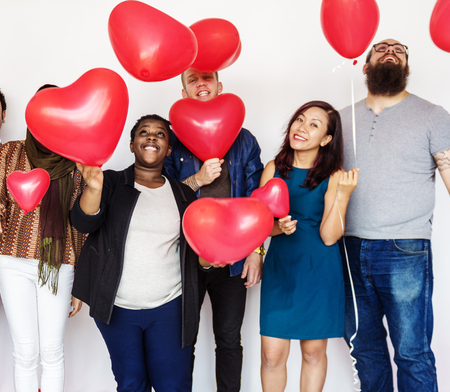 Group of Diverse People Holding Balloons Cheerful