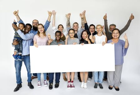 Group of diversity people with copyspace board advertising Stock Photo