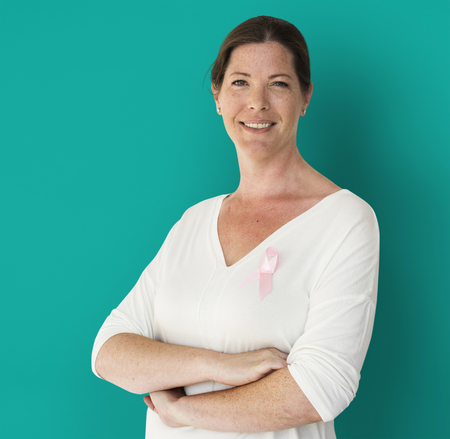 Adult Woman with Pink Ribbon on Shirt Cancer Awareness Campaign