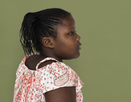 Little african girl casual studio portrait side view Reklamní fotografie