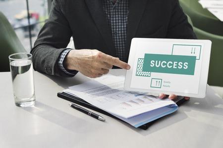 Businessman explains the goals target on digital tablet Stock fotó