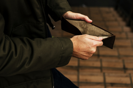Man Hands Open Checking Empty Wallet Broke Out of Cash Stock Photo