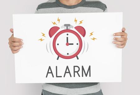 Man holding banner of alarm clock icon notification illustration Stock Photo