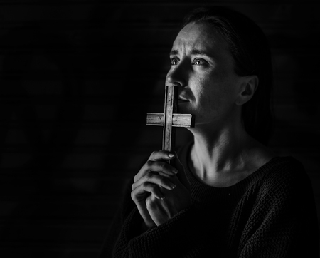 Adult Woman Hands Holding Cross Praying for God Religion Stock Photo - 79643532