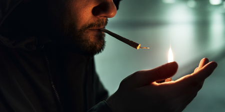 Homeless Adult Man Lightening Up Cigarette Addiction