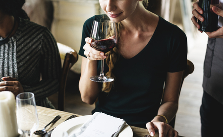 Woman Tasting Red Wine in a Classy Restaurant Stock fotó
