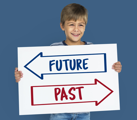 Child holding a board with the future and past Banco de Imagens