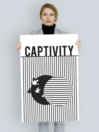 Graphic of bird unleashed from captivity to freedom Reklamní fotografie - 79584623