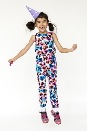 Young girl standing and posing for photoshoot