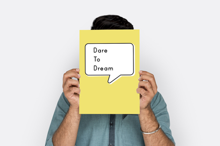 People holding a board about dare to dream quotation