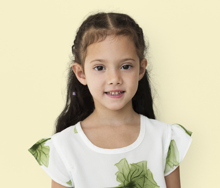 Young little girl with awkward smile expression portrait Stock Photo