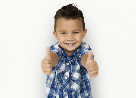 Boys showing two thumbs up Stock Photo