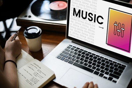 logo music: Hands working on laptop network graphic overlay Stock Photo