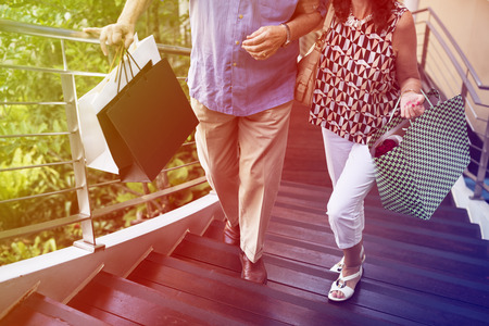 Photo Gradient Style with Senior couple climbing upstairs shopping Imagens - 79594983