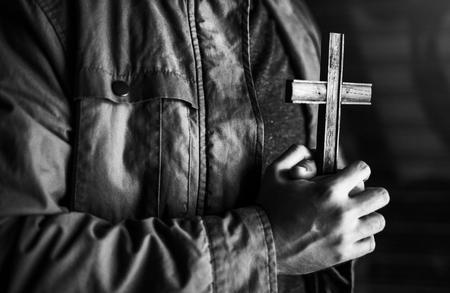 personal god: Adult Woman Hands Holding Cross Praying for God Religion Stock Photo