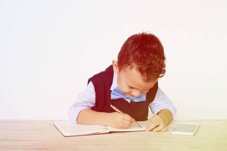 Young Schoolboy Writing Bookworm Education 版權商用圖片