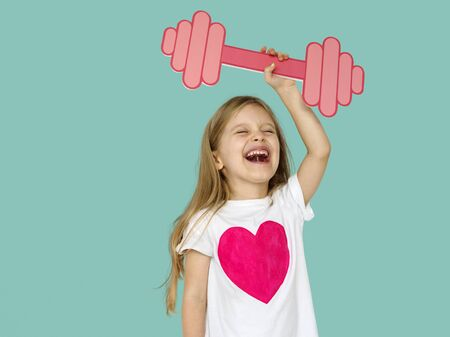 Little Girl Lifting Prapercraft Dumb Bells Stock Photo