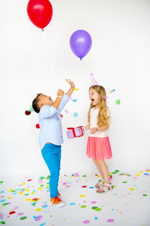 Group of kids celebrate birthday party together Reklamní fotografie