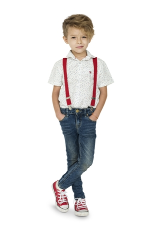 A Caucasian Boy Standing Crossing Legs Background Studio Portrait Stock fotó - 80766870