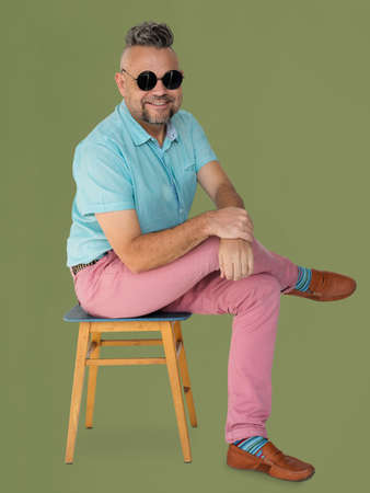 A Man with Sunglasses Sitting on a Chair