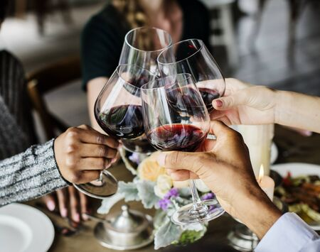 Friends Clinging Wineglasees Together Cheers Happiness Stock Photo