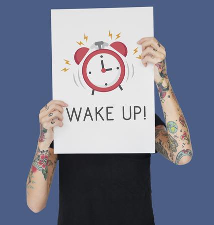 beware: Tattoo woman holding banner of alarm clock icon notification illustration Stock Photo