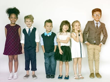 smartness: Group of young kids standing and smiling