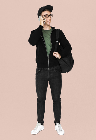 Young man with casual outfit talking phone standing