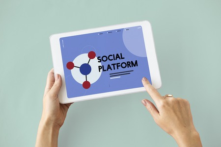 finding: Digital Tablet connected with social network online community Stock Photo