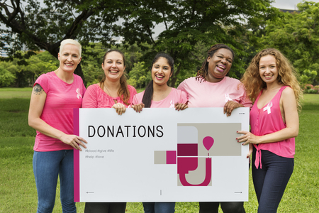 Group of women holding banner of blood donation campaign