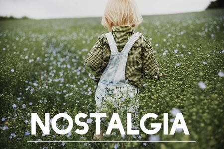 Nostalgia word on young boy outdoors
