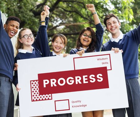 Students Group Holding Banner about Improvement Word Stock Photo