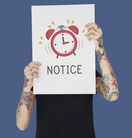 woman arms up: Tattoo woman holding banner of alarm clock icon notification illustration Stock Photo