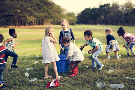 Little Kids Separating Recycle Bottles to Trash Bin