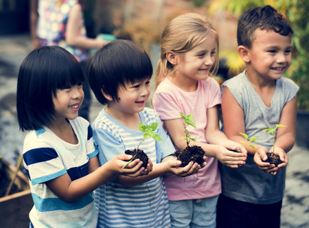 cultivating: Group of kindergarten kids friends gardening agriculture