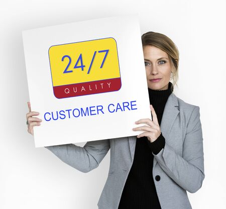 seven persons: Business person holding 247 service banner