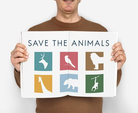 species living: Adult person holding a save the animals banner Stock Photo
