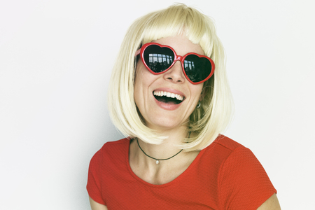 Caucasian blonde woman wearing sunglassess