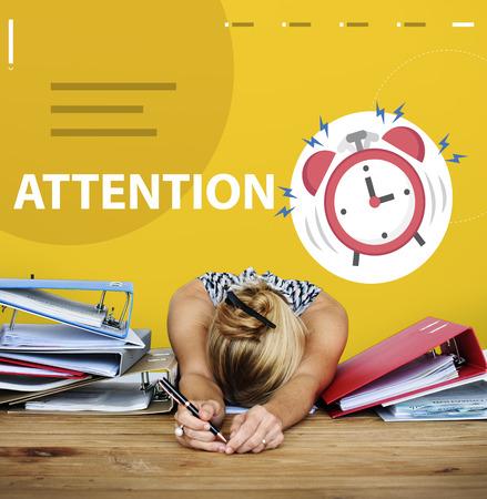 career timing: Alarm clock beating wake tired woman up Stock Photo