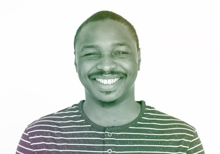 African man wearing striped t-shirt and happiness smiling Stock Photo