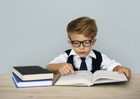 concentrate: Little Boy Businessman Working Busy Stock Photo