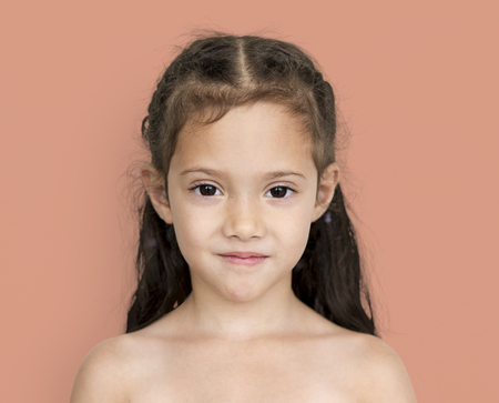 portait: Young asian girl with awkward smile shoulder and head portait Stock Photo